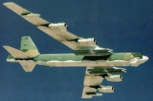 A B-52H bomber with a full load of 12 Advanced Cruise Missiles under the wings. (Click to enlarge.)
